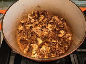 Seasoned ground chicken cooking in pot for Tex Mex Unstuffed Peppers with Ground Chicken.  Juicy Sweet Bell Peppers are chopped up and cooked with the Tex Mex style ground chicken, tomatoes, Mexican seasonings, cheese, rice and corn tortillas.