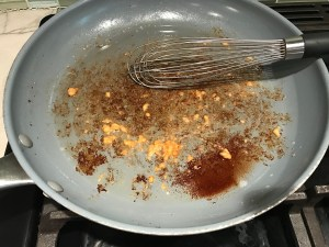 Garlic added to bacon fat in large frying pan for Velvety Barley Recipe with Bacon and Gruyere Cheese.  It's creamy, rich, nutty, smokey, hearty, and utterly delicious.