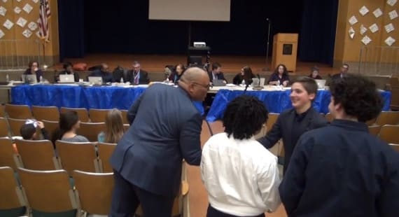 NRHS Principal Reggie Richardson Congratulates Students Following School Board Meeting at Trinity School