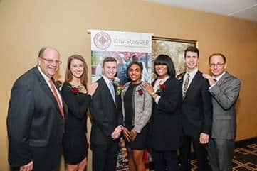Left to right: Honoree, Ronald M. DeFeo '74, '13H, Madison Kirch '18, Kalen Sullivan '17, Merridith Delinois '16, Marci Dillion '15, Patrick Lynch '17, President Joseph E. Nyre, Ph.D.