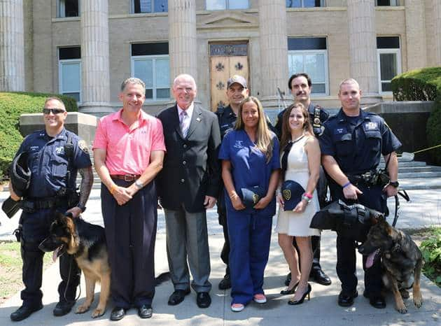 Front Row (Left to Right): P.O Mark Weinerman with Police Canine Tank, City Manager Chuck Strome, Police Commissioner Patrick Carroll, Jennifer Ubl, Jessica Levine, P.O Matthew Glass with Police Canine Valor Back Row (Left to Right):  Lt. Collins Coyne an