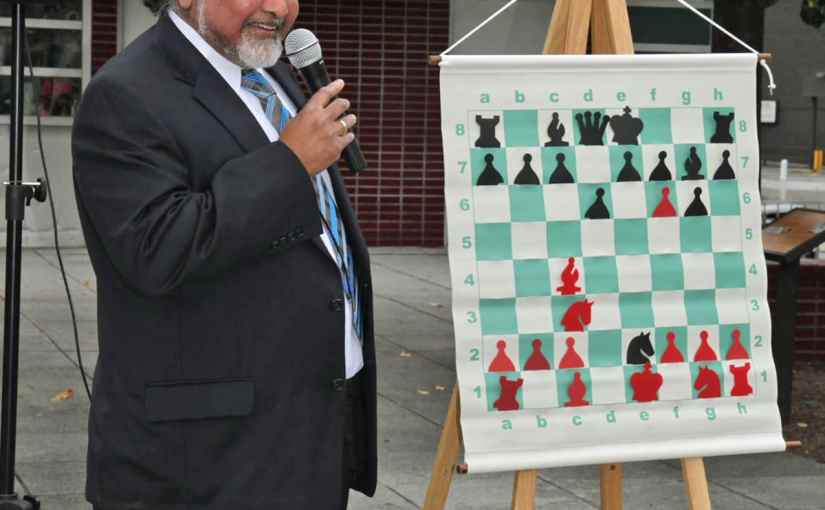 Sunil Weeramantry, Executive Director of the National Scholastic Chess Foundation, delivers a lecture as part of Chess in the Park being held on Columbus Day at the New Rochelle Library. The free event includes open play for all ages and abilities, a simu