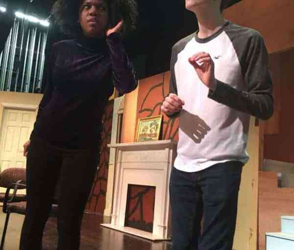 Elwood P. Dowd (NRHS senior Nicholas Baker, right) introduces Mrs. Ethel Chauvenet (senior Brea Watkins) to his new invisible friend in a Theatre Works rehearsal of Harvey.