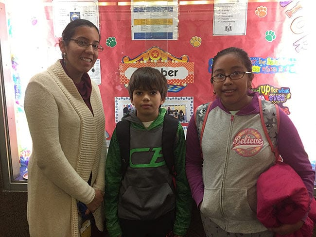 Trinity school counselor Melissa Kelly with Erick Alvarez and Catalina Fuentes.