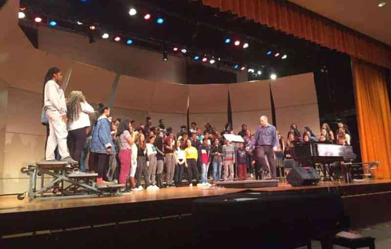 Choral students prep for their holiday performance with the guidance of Choral Director Jeremy Barbaro.