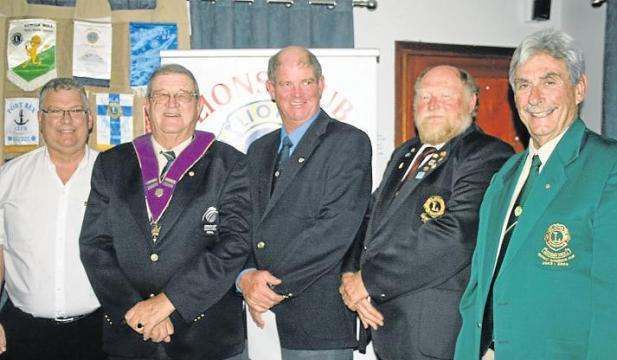 FOLLOWING IN DAD'S FOOTSTEPS: Mark Elliott, the son of Lion president Norman Elliott, was inducted into the Port Alfred Lions Club earlier this month. He was sponsored by Lion Rob Brunette, while the induction ceremony was conducted by past council chairman Mike Newlands. Pictured are, from left, visiting zone chairman Leslie Human from East London, Lion president Norman Elliott, newly inducted Lion Mark Elliott, sponsoring Lion Rob Brunette and past council chairman Mike Newlands