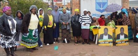 COME RAIN OR SUNSHINE: The ANC supporters for Ward 7 stand strong in cold conditions outside the voting station at Kuyasa Combined School