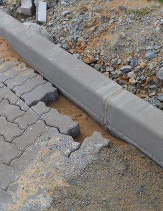 CRACKS APPEARING: A retired engineer pointed out subsiding bricks on the newly paved section of Beach Road, which is where problems would start, he said. Also, road edges are not adequately cemented so the pavers separate and potholes may occur Picture: LOUISE KNOWLES