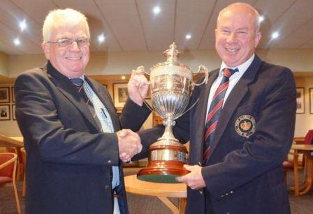 GOLDEN MOMENT: Captain of Royal Harare, Richard Robinson, hands over the tournament trophy to winning captain Steve Gardner of Royal Port Alfred Golf Club after the local lads won the Five Royals Golf Tournament last weekend Picture: LOUISE CARTER