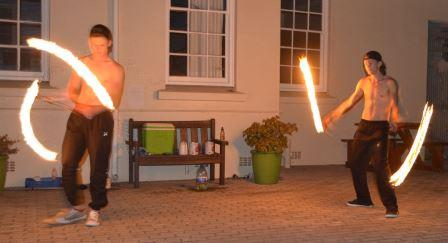 SOME LIKE IT HOT: Fire dancers Divan Loubscher, left, and Sloan Venter, entertained the crowds outside during interval