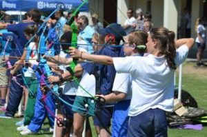 ARROWS FLYING: Port Alfred High School pupil Abigail Janse van Rensburg, on far right, in action with the junior section of the inter-schools archery bull eye competition held at PAHS last Saturday Picture: JON HOUZET