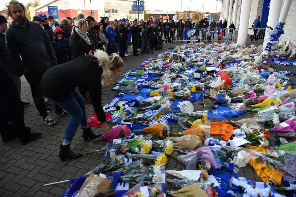 People arrived in their droves to pay respect to the victims  Leicester City confirm owner Vichai Srivaddhanaprabha one of five people to have died in helicopter crash GettyImages 1054583826