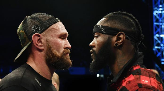 Tyson Fury and Deontay Wilder squared up in the ring for the first time in Belfast
