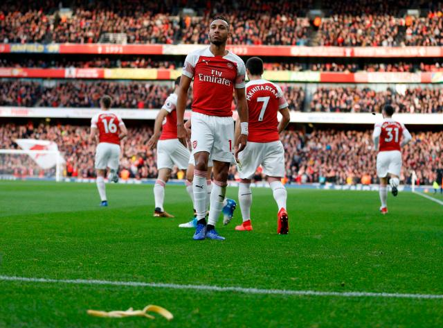 Arsenal forward Aubameyang looks into the crowd in disbelief after seeing the banana land close to him back in December