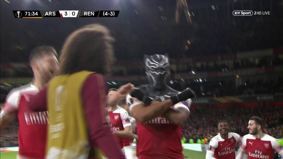Aubameyang does the trademark salute from Black Panther while his team-mates congratulate him