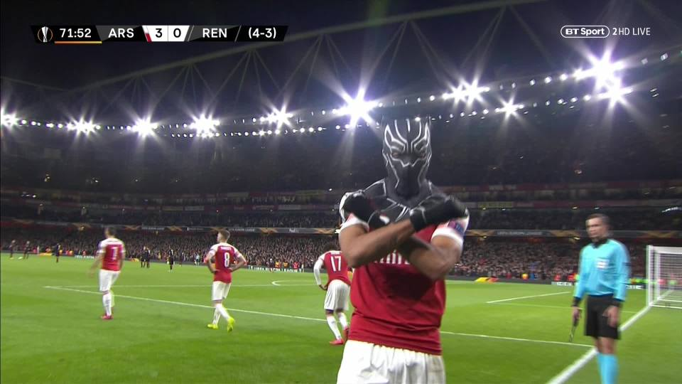 Aubameyang maintains the pose while the Emirates Stadium crowd cheers his name