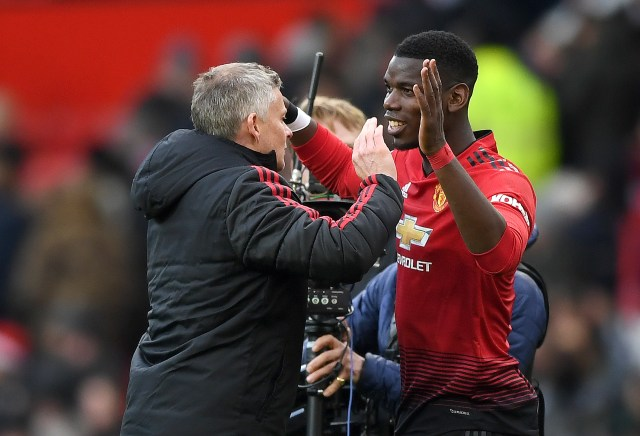 The Norwegian boss celebrates with matchwinner Paul Pogba after his brace of penalties