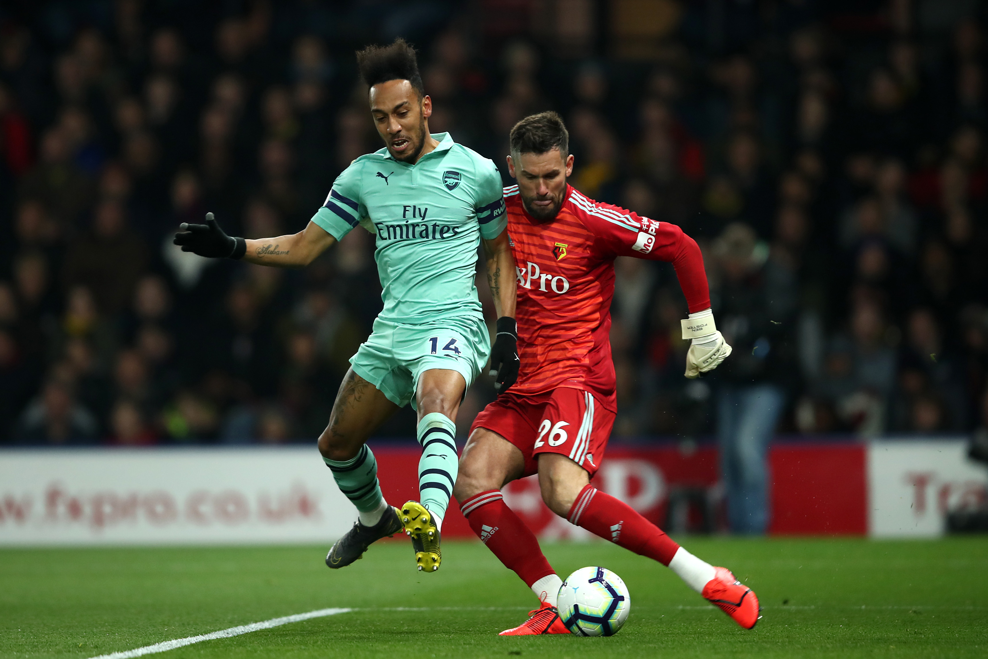 Pierre-Emerick Aubameyang challenges Ben Foster for the goal