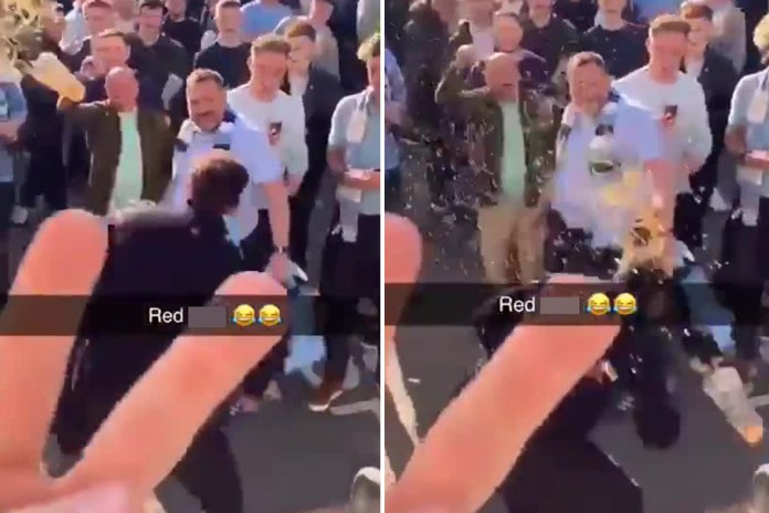 Gary Neville had a pint thrown at him by Man City fans