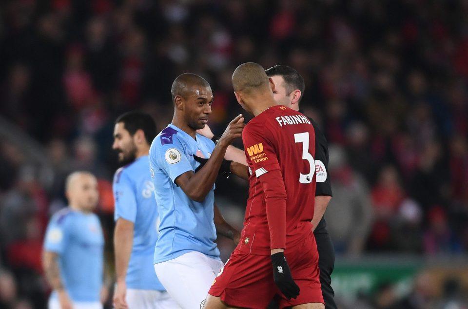 Fernandinho confronts Liverpool goalscorer Fabinho