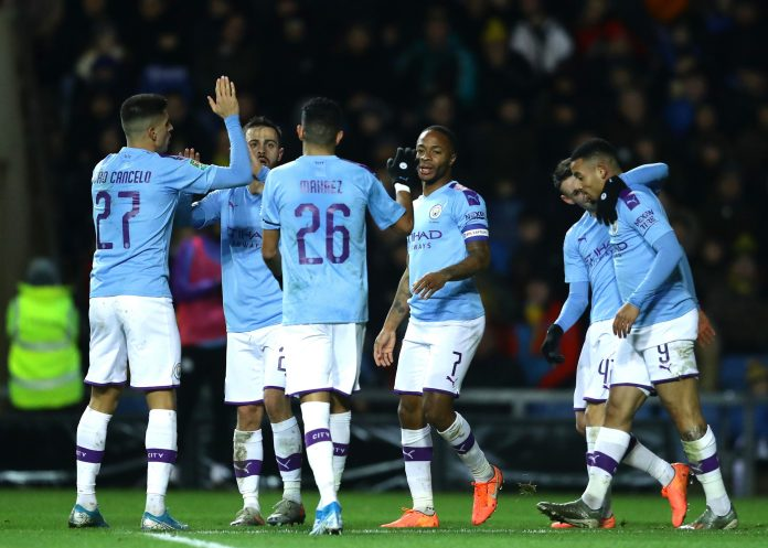 Raheem Sterling celebrates with his City teammates