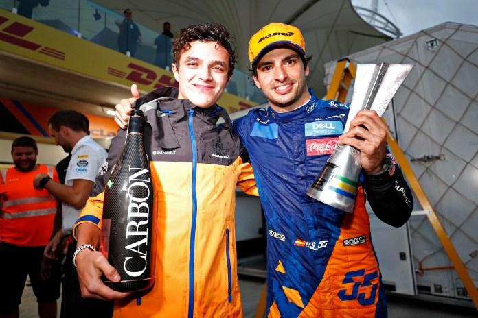 Carlos Sainz celebrates his third place finish at the Brazilian GP last season with McLaren teammate Lando Norris