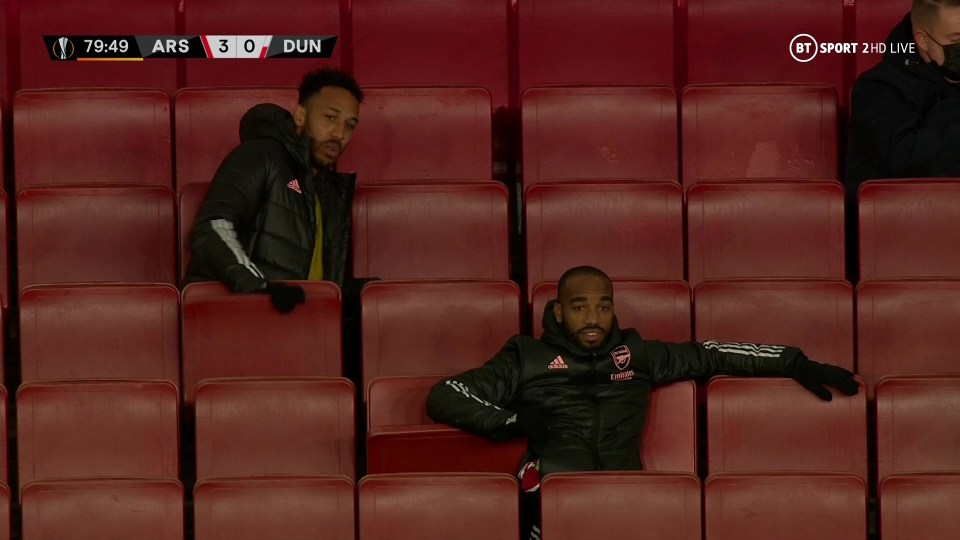 Aubameyang can be seen holding the seat in front of him