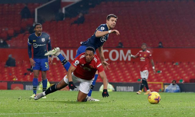 Bednarek was sent off after this challenge on Anthony Martial but his red card was later overturned following an appeal