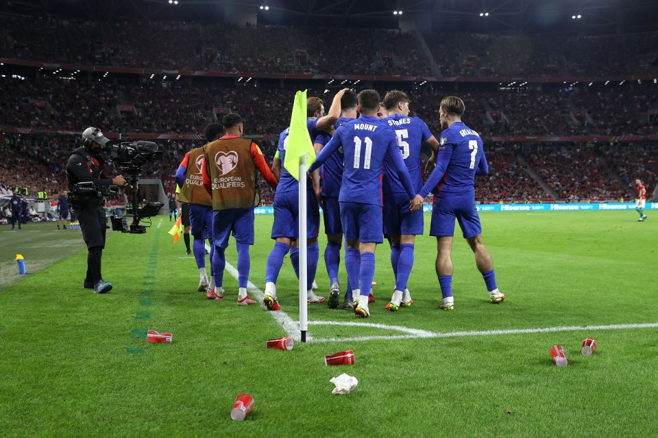 Cups and projectiles were thrown at celebrating England players multiple times at the Puskas Arena.