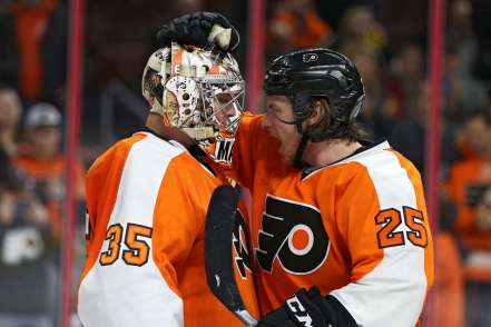 Forward Ryan White Celebrates the Flyers win with goalie Steve Mason
