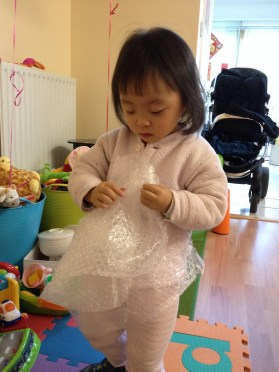 Annabelle loves popping the bubble wrap.