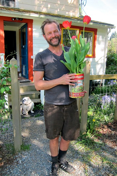 handsome adam with May Day tulips