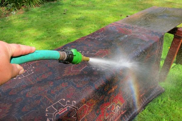 hosing off rug