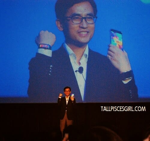 Samsung Galaxy S5 Launch in Malaysia - Lee Dong Yong, President of Samsung Malaysia Electronics showing off Samsung Galaxy S5 and Samsung Gear Fit