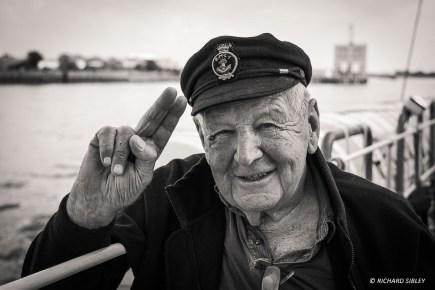 An RNLI veteran enjoying a day out, onboard the Dutch Schooner Gulden Leeuw.