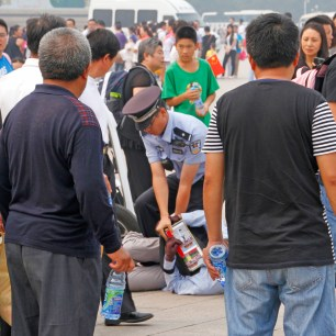 The policeman wrestled the vendor to the ground