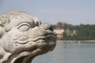 One of the lions lining the bridge