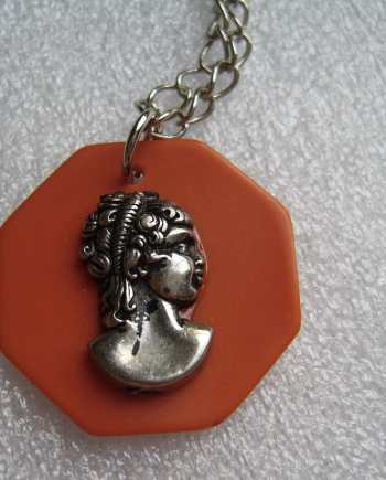Vintage early plastic galalith cameo pendant necklace - bakelite style.