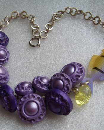 Vintage early plastic buttons and celluloid fish necklace.