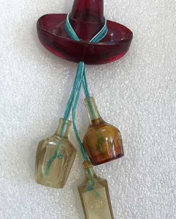 Vintage celluloid hat & bottles pin brooch