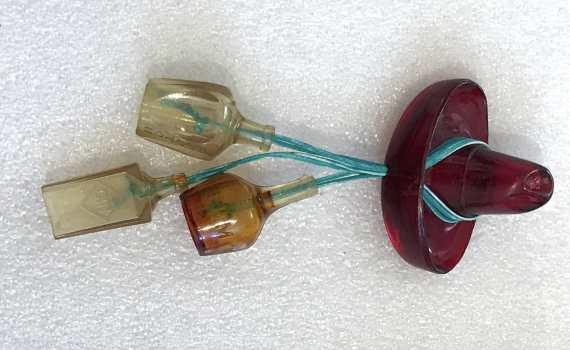 Vintage celluloid hat & bottles pin brooch