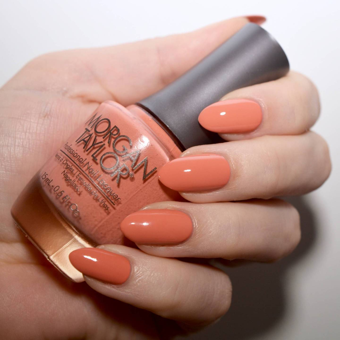Morgan Taylor Perfect Landing - a muted coral that is an alternative to the bright spring pastels.