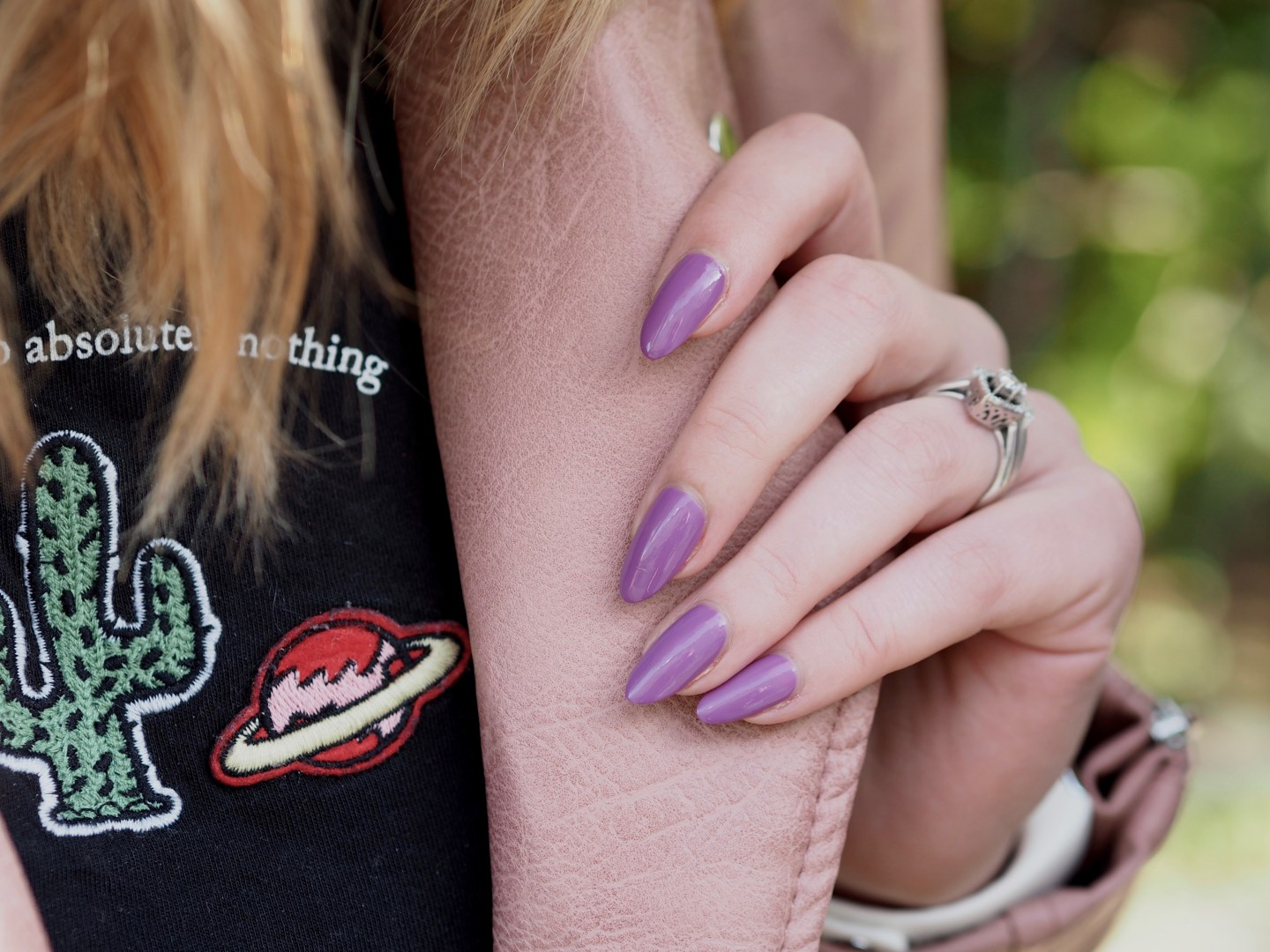 Blush pink leather jacket, purple nails
