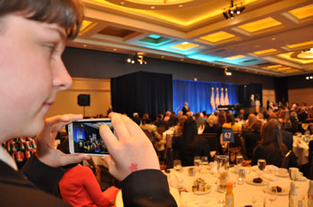 How soon he forgets: Max takes a photo of Obama speaking in Hollywood FL