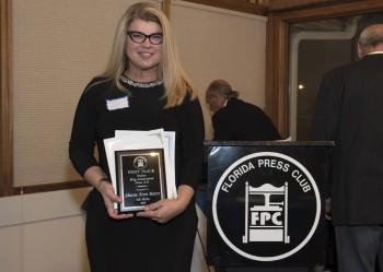 Sharon Aron Baron with award from the Florida Press Club