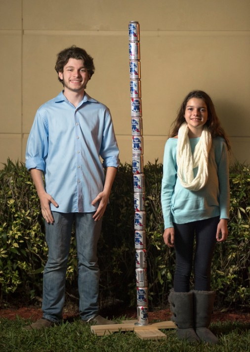 Children posing with the Festivus Pole at the Tamarac Community Center