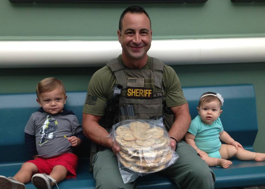 "BSO Deputy Vincent Ciacciarelli with ""Cookies for a Cop"" volunteers Gunner and Emery. - Photo Courtesy BSO"