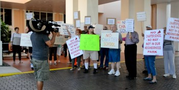 Residents protest in Kings Point during meeting last January.