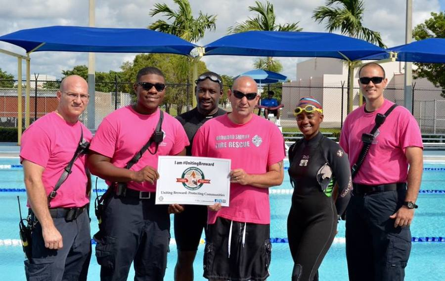 BSO Fire Chief Ken Kronheim and members of Fire Rescue Station 37 joined with community members at the Lauderdale Lakes Swimming Complex. Together, they were ‪Uniting Broward‬ by raising funds for Breast Cancer Awareness. Photo Courtesy BSO.