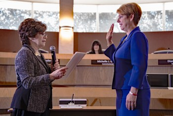 Newly elected Broward County Commissioner Nan Rich swearing in Julie Fishman.